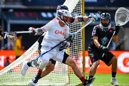 Chaos' Connor Fields advances on the goal as Chrome's Brett Queener defends during a Premier Lacrosse League game on in Washington
