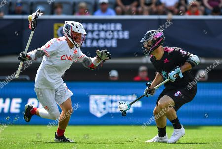 Chaos' Connor Fields advances as Chrome's Mike Manley defends during a Premier Lacrosse League game on in Washington