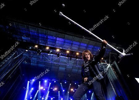 Stock Photo of Swedish band 'Europe' singer Joey Tempest performs on stage during the Rock Fest concert played at the Santa Coloma de Gramanet's Can Zam park in Barcelona, Spain, 07 July 2019.