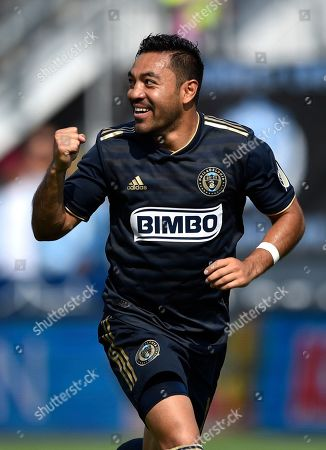 Philadelphia Union's Marco Fabian celebrates after scoring a goal past Orlando City goalkeeper Brian Rowe during the first half of an MLS soccer match, in Chester, Pa