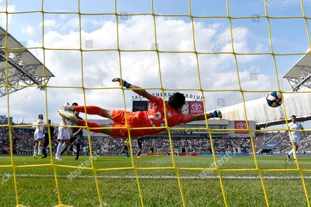 Orlando City goalkeeper Brian Rowe dives for but is unable to make a save on a goal scored by Philadelphia Union's Marco Fabian during the first half of an MLS soccer match, in Chester, Pa