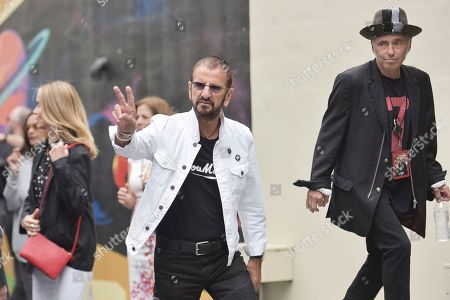 Stock Photo of Ringo Starr and Nils Lofgren attend Ringo's 11th Annual Peace and Love birthday celebration at Capitol Records Tower, in Los Angeles