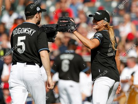Jennie Finch, Softball Olympian (R), and Scott Rogowsky, Comedian and Host (L) slap globes during the All-Star Celebrity Softball  Game at Progressive Field in Cleveland, Ohio, USA, 07 July 2019.