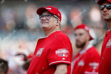 Actor Drew Carey watches during the All-Star Celebrity Softball  Game at Progressive Field in Cleveland, Ohio, USA, 07 July 2019.