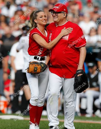 Stock Image of Actor Drew Carey (R) and Allie LaForce, Turner Sports Broadcaster (L) after a play at the All-Star Celebrity Softball  Game at Progressive Field in Cleveland, Ohio, USA, 07 July 2019.