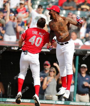 J.R. Smith (R) celebrates with Mike 'The Miz' Mizanin, WWE Superstar (L) after scoring during the All-Star Celebrity Softball  Game at Progressive Field in Cleveland, Ohio, USA, 07 July 2019.