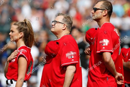 Actor Drew Carey (C), Turner Sports Broadcaster, Allie LaForce (L), and Former NFL American Football player Joe Thomas during the national anthem at the All-Star Celebrity Softball  Game at Progressive Field in Cleveland, Ohio, USA, 07 July 2019.