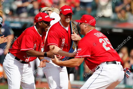 Former MLB All-Star Jim Thome (R) is greeted by Former MLB All-Star Kenny Lofton (L) and Stipe Miocic, MMA Fighter (C) during introductions at the All-Star Celebrity Softball  Game at Progressive Field in Cleveland, Ohio, USA, 07 July 2019.