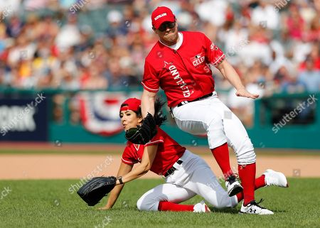 Mike 'The Miz' Mizanin, WWE Superstar (R) collides with actress Stephanie Beatriz (L) in a play during the All-Star Celebrity Softball  Game at Progressive Field in Cleveland, Ohio, USA, 07 July 2019.