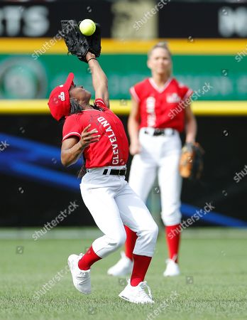 Simone Biles, Olympic Gold Medal Gymnast (L) in action as Allie LaForce, Turner Sports Broadcaster (R) looks on during the All-Star Celebrity Softball  Game at Progressive Field in Cleveland, Ohio, USA, 07 July 2019.
