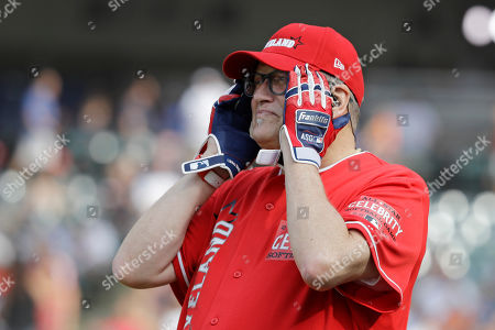 Drew Carey watches the All-Star MLB Celebrity Softball Game, in Cleveland. The MLB baseball All-Star Game is to be played Tuesday
