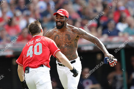 "J.R. Smith, right, and Mike ""The Miz"" Mizanin celebrate during the All-Star MLB Celebrity Softball game, in Cleveland. The 90th MLB baseball All-Star Game will be played Tuesday"
