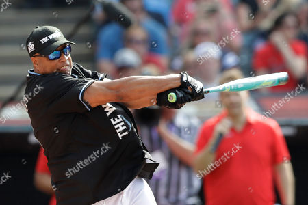 Bernie Williams hits during the All Star MLB Celebrity Softball Game, in Cleveland. The MLB baseball All-Star Game is to be played Tuesday