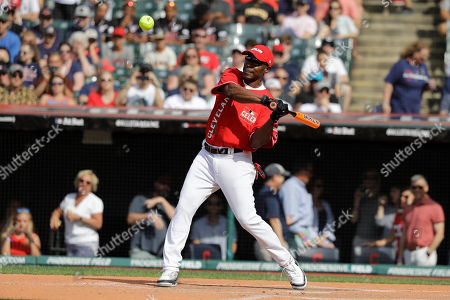 Stock Image of Kenny Lofton hits during the All Star MLB Celebrity Softball Game, in Cleveland. The MLB baseball All-Star Game is to be played Tuesday
