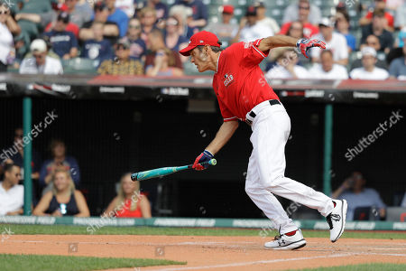 Dr. Oz hits during the All-Star MLB Celebrity Softball Game, in Cleveland. The MLB baseball All-Star Game is to be played Tuesday