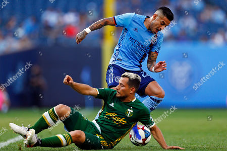 New York City defender Ronald Matarrita, top, controls the ball against Portland Timbers midfielder Sebastian Blanco during the first half of an MLS soccer match, in New York