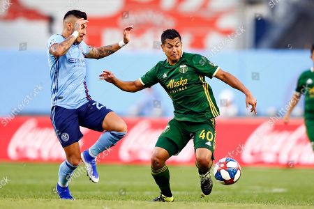 Portland Timbers midfielder Renzo Zambrano (40) battles for the ball with New York City defender Ronald Matarrita during the second half of an MLS soccer match, in New York