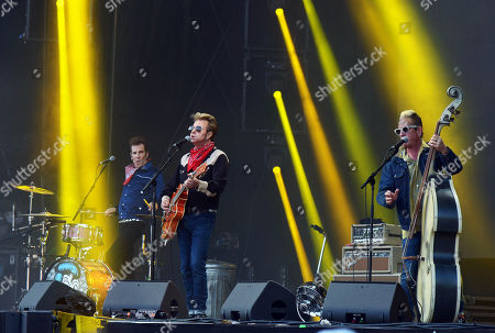 Drummer Slim Jim Phantom (L), guitarrist Brian Setzer (L) and bassist Lee Rocker (R) of the US rockabilly band 'Stray Cats' perform during the 31st Eurockeennes Festival in Belfort, France, late 07 July 2019 (issued 08 July 2019). The music festival ran from 04 to 07 July 2019.