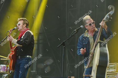 Stock Photo of Guitarrist Brian Setzer (L) and bassist Lee Rocker (R) of the US rockabilly band 'Stray Cats' perform during the 31st Eurockeennes Festival in Belfort, France, late 07 July 2019 (issued 08 July 2019). The music festival ran from 04 to 07 July 2019.
