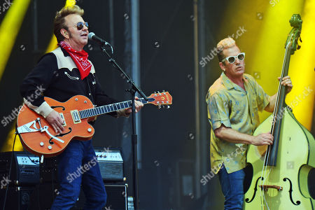 Guitarrist Brian Setzer (L) and bassist Lee Rocker (R) of the US rockabilly band 'Stray Cats' perform during the 31st Eurockeennes Festival in Belfort, France, late 07 July 2019 (issued 08 July 2019). The music festival ran from 04 to 07 July 2019.