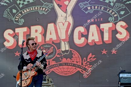 Stock Image of Guitarrist Brian Setzer of the US rockabilly band 'Stray Cats' performs during the 31st Eurockeennes Festival in Belfort, France, late 07 July 2019 (issued 08 July 2019). The music festival ran from 04 to 07 July 2019.