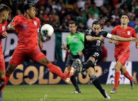 Andres Guardado, Weston Mckennie. Mexico midfielder Andres Guardado (18) shoots against United States midfielder Weston Mckennie (8) during the second half of the CONCACAF Gold Cup final soccer match in Chicago, . Mexico won 1-0