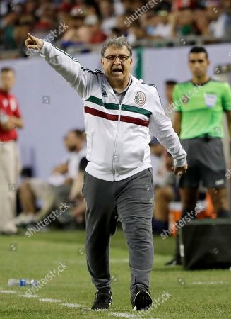 Mexico head coach Gerardo Martino calls to his team during the first half of the CONCACAF Gold Cup final soccer match against United States in Chicago, . Mexico won 1-0