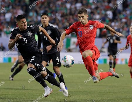 Christian Pulisic, Carlos Salcedo. United States midfielder Christian Pulisic, right, controls the ball against Mexico defender Carlos Salcedo during the first half of the CONCACAF Gold Cup final soccer match at Soldier Field in Chicago
