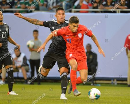 US midfielder, Christian Pulisic (10), and Mexico defender, Carlos Salcedo (3), fight for control of the ball during the CONCACAF Gold Cup, championship match, between the United States and Mexico, at Soldier Field in Chicago, IL. Credit: Kevin Langley/CSM