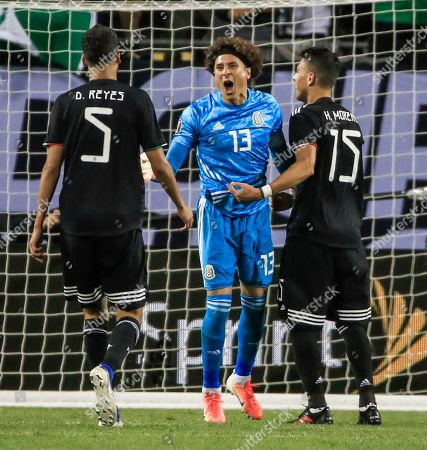 Mexico goalkeeper Guillermo Ochoa (C) celebrates as time expires with Mexico Defender Diego Reyes (L) and Mexico defender Hector Moreno (R) in the Concacaf Gold Cup final match between Mexico and the United States at Soldier Field in Chicago, Illinois, USA, 07 July 2019. Mexico defeated the US.
