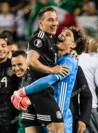Mexico midfielder Andres Guardado (L) and Mexico goalkeeper Guillermo Ochoa (R) celebrate their win in the Concacaf Gold Cup final match between Mexico and the United States at Soldier Field in Chicago, Illinois, USA, 07 July 2019. Mexico defeated the US.