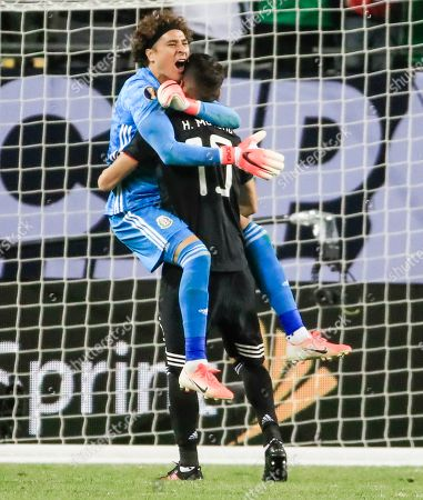 Mexico goalkeeper Guillermo Ochoa (L) and Mexico defender Hector Moreno (R) celebrate as time expires in the Concacaf Gold Cup final match between Mexico and the United States at Soldier Field in Chicago, Illinois, USA, 07 July 2019. Mexico defeated the US.