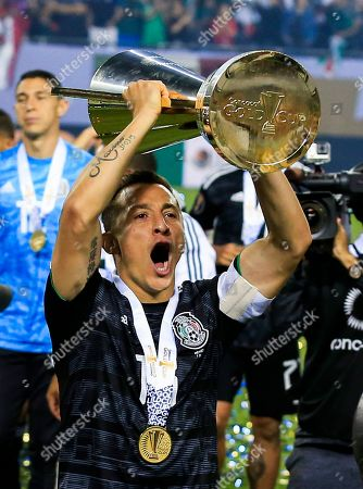 Mexico midfielder Andres Guardado celebrates with the Gold Cup after winning the Concacaf final match between Mexico and the United States at Soldier Field in Chicago, Illinois, USA, 07 July 2019. Mexico defeated the US.