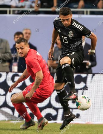 Mexico defender Hector Moreno (R) in action against USA forward Jordan Morris (L) in the first half of the Concacaf final match between Mexico and the United States at Soldier Field in Chicago, Illinois, USA, 07 July 2019.