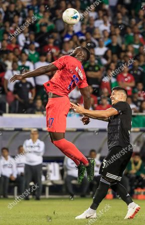 USA forward Jozy Altidore (L) in action against Mexico defender Carlos Salcedo (R) in the first half of the Concacaf final match between Mexico and the United States at Soldier Field in Chicago, Illinois, USA, 07 July 2019.