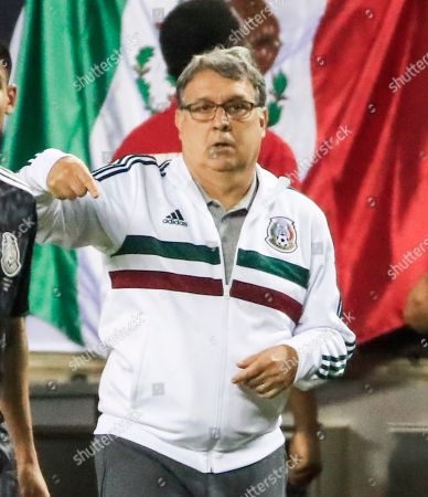 Mexico head coach Gerardo Martino directs his team in the Concacaf Gold Cup final match between Mexico and the United States at Soldier Field in Chicago, Illinois, USA, 07 July 2019. Mexico defeated the US.