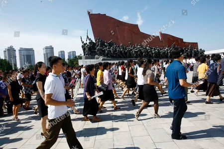 People visit Mansu Hill to pay tribute to the late leaders Kim Il Sung and Kim Jong Il on the occasion of the 25th anniversary of Kim Il Sung's death, in Pyongyang, North Korea
