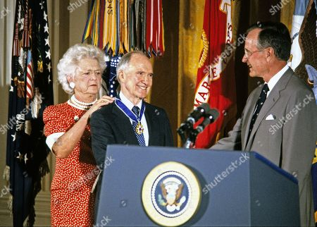 United States President George H.W. Bush and first lady Barbara Bush present the Presidential Medal of Freedom to National Security Advisor Brent Scowcroft during a ceremony in the East Room of the White House in Washington, DC. General Scowcroft is being honored for his efforts to ensure the success of Operation Desert Shield / Operation Desert Storm and the liberation of Kuwait.