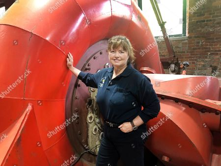 Natural Power Group co-owner Sarah Bower-Terbush stands in front of a power turbine at the company's hydroelectric site in Wappingers Falls, N.Y. She and her husband sell renewable power to local customers from three hydroelectric sites they operate in the Hudson Valley. Customers say they like investing their money locally in clean power