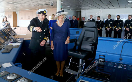 Stock Picture of Camilla Duchess of Cornwall, Patron of The Silver Line, a charitable partner of Saga Group, with Captain Julian Burgess on the bridge of Saga Group's new cruise ship the Spirit of Discovery after its official naming ceremony