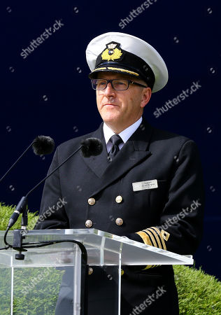 Stock Photo of Captain Julian Burgess makes a speech in front of the Saga Group's new cruise ship, the Spirit of Discovery, before its official naming ceremony