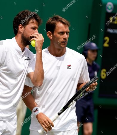 Robin Haase (L) of the Netherlands and Frederik Nielsen of Denmark in action against Raven Klaasen of South Africa and Michael Venus of New Zealand during their Men's Doubles match at the Wimbledon Championships at the All England Lawn Tennis Club, in London, Britain, 08 July 2019.