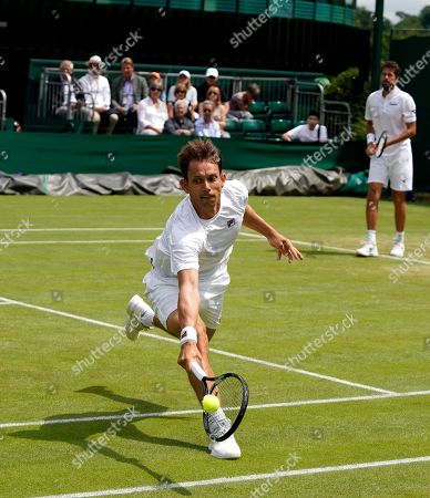 Robin Haase (R) of the Netherlands and Frederik Nielsen of Denmark in action against Raven Klaasen of South Africa and Michael Venus of New Zealand during their Men's Doubles match at the Wimbledon Championships at the All England Lawn Tennis Club, in London, Britain, 08 July 2019.