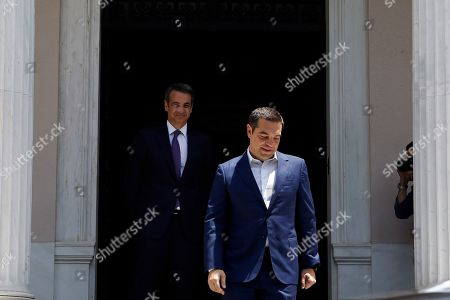 Outgoing Prime Minister Alexis Tsipras (R) leaves the Prime Minister's office after handing over power to the newly appointed Kyriakos Mitsotakis (L), at Maximos Mansion in Athens, Greece, 08 July 2019. New Democracy won general elections in Greece on 07 July and will form a majority government. A total of six parties will enter parliament based on the results. Voter participation reached 57.92 percent.
