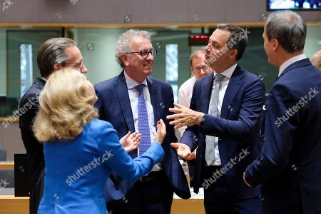 (L-R) Spanish Economy Minister Nadia Calvino, German Deputy finance minister Joerg Kukies, Luxembourg's Finance Minister Pierre Gramegna, and Belgian Minister of Finance Alexander De Croo during the Eurogroup Finance Ministers' meeting in Brussels, Belgium, 08 July 2019.