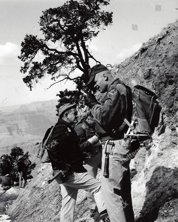 This undated photo provided by the U.S. Geological Survey Astrogeology Science Center shows geologist Dale Jackson, left, and astronaut Neil Armstrong, right, studying rocks at Grand Canyon National Park in Arizona. Every astronaut who landed on the moon trained in northern Arizona