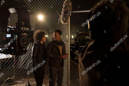 Alexandra Shipp as Sasha Arias and Jessie T. Usher as JJ Shaft
