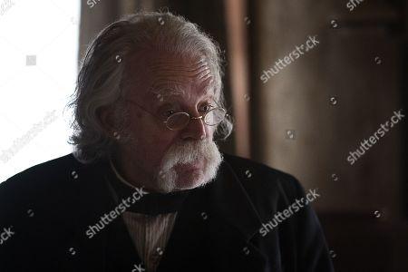Brad Dourif as Doc Cochran