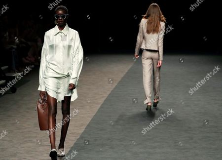 Stock Photo of Models present creations from the Spring-Summer 2020 collection by Roberto Torretta during the 70th Mercedes-Benz Fashion Week Madrid, in Madrid, Spain, 08 July 2019. The MBFWM runs from 05 to 10 July.
