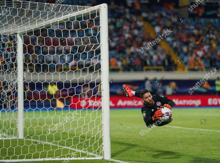 FRANCE OUT Hassen Mouez of Tunisia saving a shot during the African Cup of Nations match between Ghana and Tunisia at the Ismailia Stadium in Ismailia, Egypt